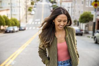 Laughing young woman on the street