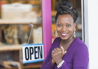 https://cf.ltkcdn.net/womens-fashion/images/slide/253662-850x595-11_Business_woman_front_door_shop.jpg