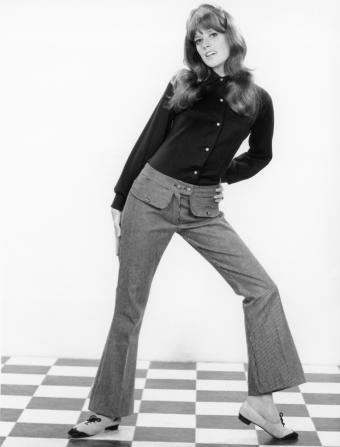 Woman posing in 1950s or 1960s era clothing