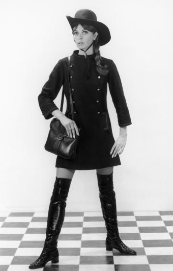 Young woman in mod dress, boots and hat