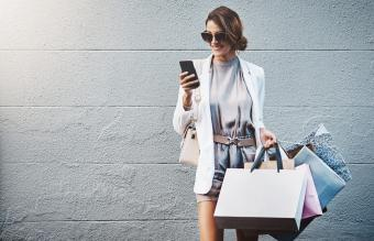 elegant young woman out shopping