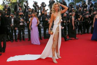 Lady Victoria Harvey with shiny dress and leggings at the 74th annual Cannes Film Festival on July 11, 2021 - Getty Editorial Use