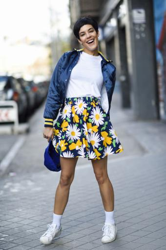 Fashionable young woman wearing a A-line skirt