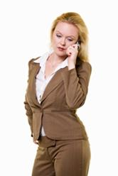 Woman wearing a brown spring suit