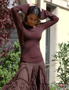 Petite woman dressed in monochrome fashion