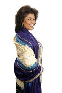 Image of a Columbian woman wearing a silk ruana