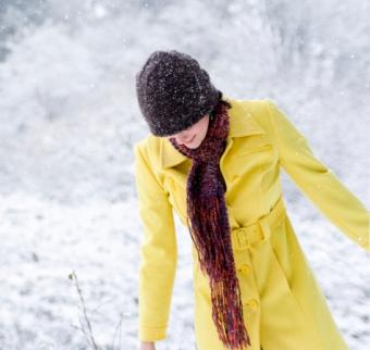 woman wearing a colorful winter scarf