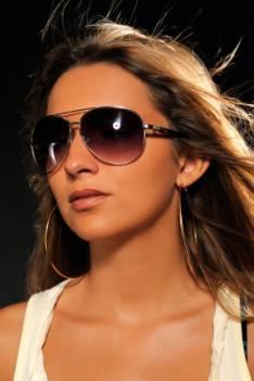 Young woman wearing fashionable sunglasses