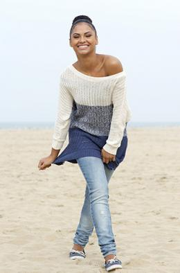 Skinny jeans worn with an oversized sweater