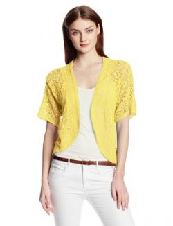 Woman in a yellow crocheted shrug sweater