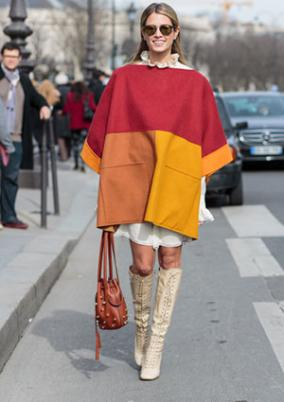 Woman wearing modern color block cape