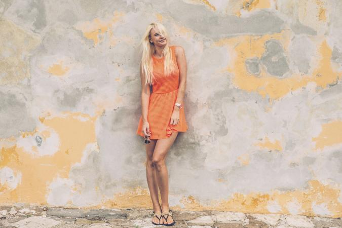 Woman in an orange summer dress