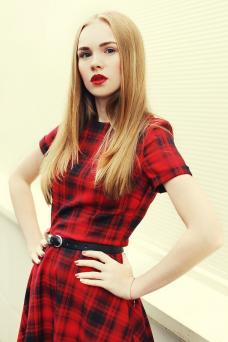 Woman wearing red checkered preppy dress