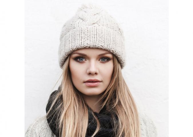 Girl in white knit hat