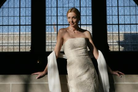 Woman in an evening gown with a pashmina stole