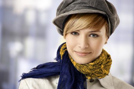 Hollywood-style pashminas around woman's neck