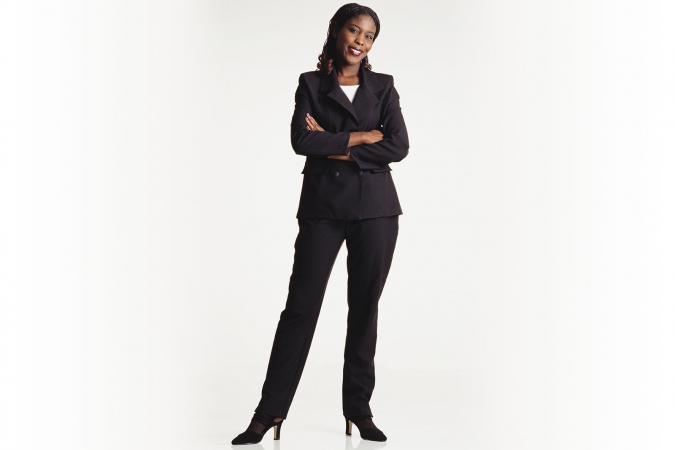 Woman in dark black suit