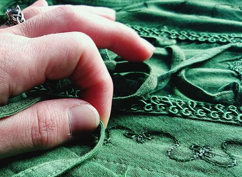 Hand Touching Fabric