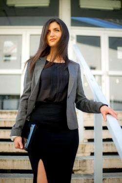 woman in city wearing gray blazer
