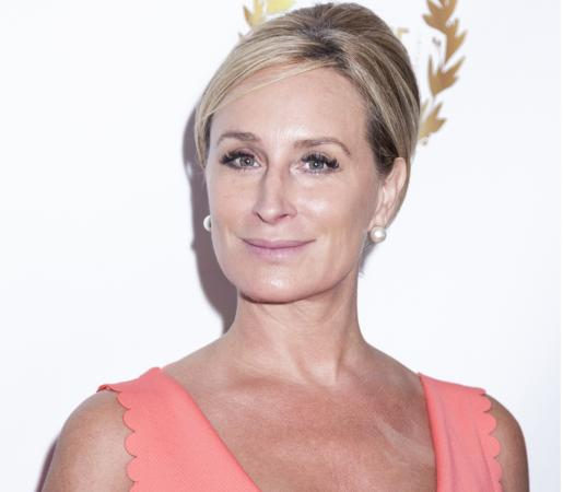 Sonja Morgan in salmon-colored dress