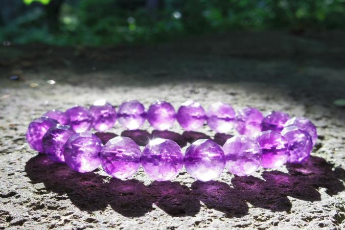Closeup of DIY purple bead bracelet