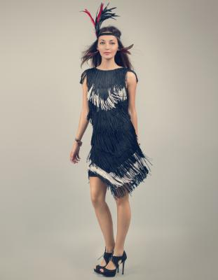 Fringed flapper girl on grey background