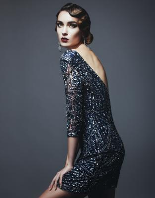 Glamorous woman in vintage sequin dress