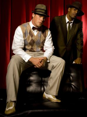2 men in Gatsby-style clothing