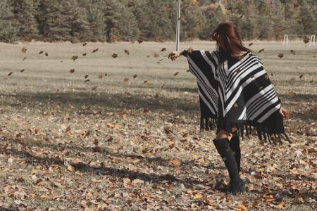 Girl wearing striped poncho