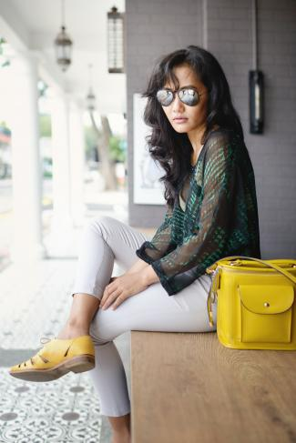 Trendy woman with yellow purse and shoes