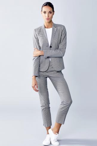 Confident businesswoman in gray suit
