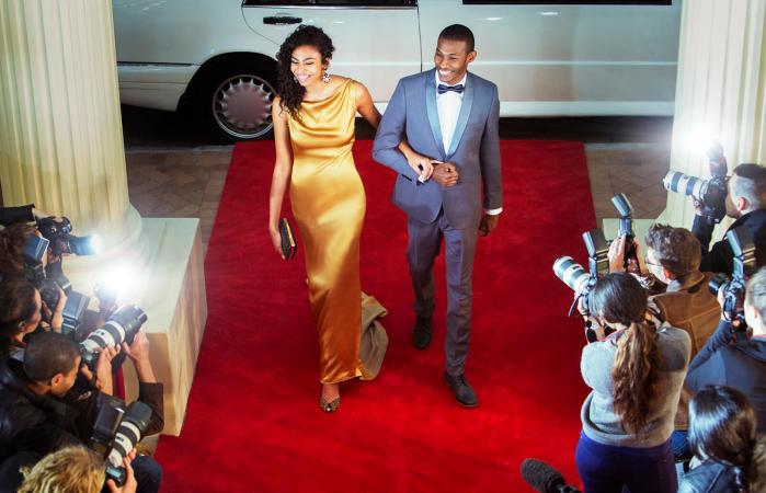 a0255c8e5c919 What Do Women Wear to Black Tie Events? By Katie Davies BA Fashion  Marketing. Celebrity couple arriving at red carpet event