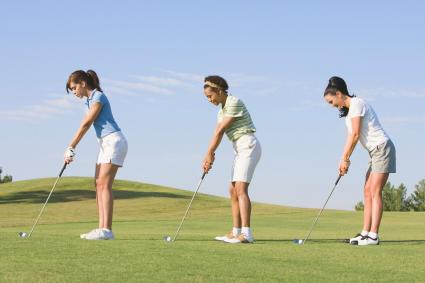 Women playing golf in shorts