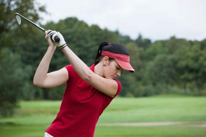 Woman wearing red golf visor