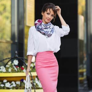 Fashionable businesswoman in pink pencil skirt