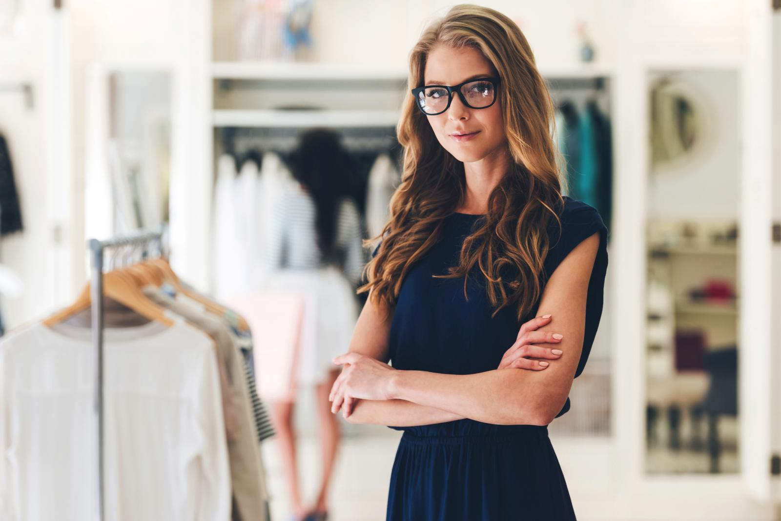 Woman in glasses standing at the clothing store