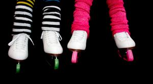 Girls wearing 80's style leg warmers and skates