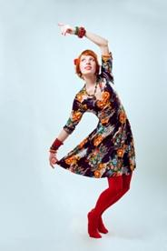 Woman dancing in a flowy dress and tights
