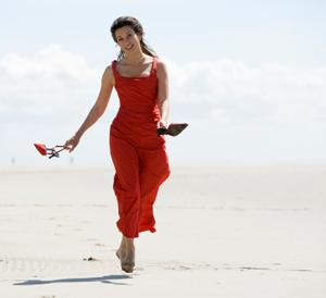 Woman wearing a red sundress at the beach