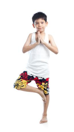 Child doing tree pose