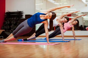 Doing a side plank for yoga class