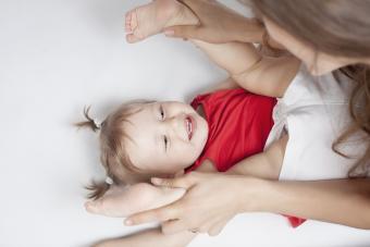 Baby lying near mother
