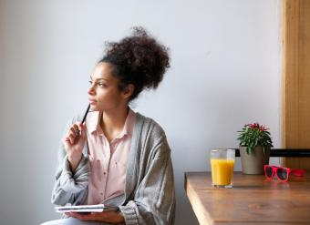 Woman with pen and paper
