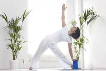 Woman exercising with yoga block
