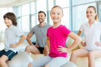 children sitting on yoga balls