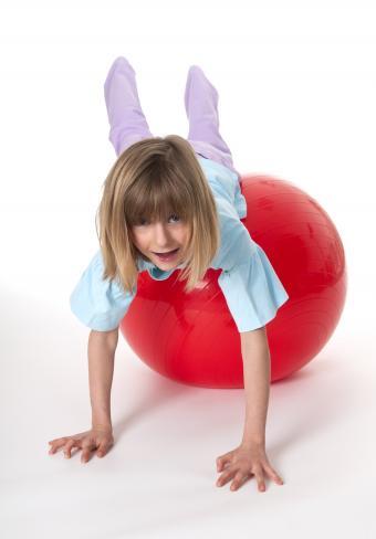 Girl doing plank using yoga ball