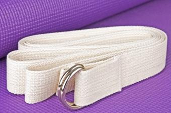 How to Use a Yoga Strap to Carry Your Mat