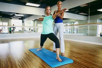 Woman working with yoga teacher