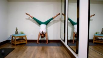 Image of woman lifting legs into handstand