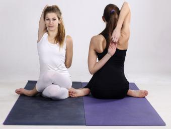 Two women showing cow face pose